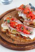 Delicious Bruchetta with ham and tomato — Stock Photo