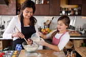 Mother and daughter together in kitchen — Стоковое фото