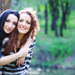 Stock Photo: Two sisters in the park