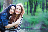 Two sisters in the park — Stock Photo