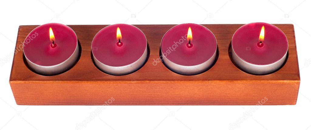 Wooden candleholder or candlestick with four burning or flaming  candles isolated on white background — Stock Photo #10218538