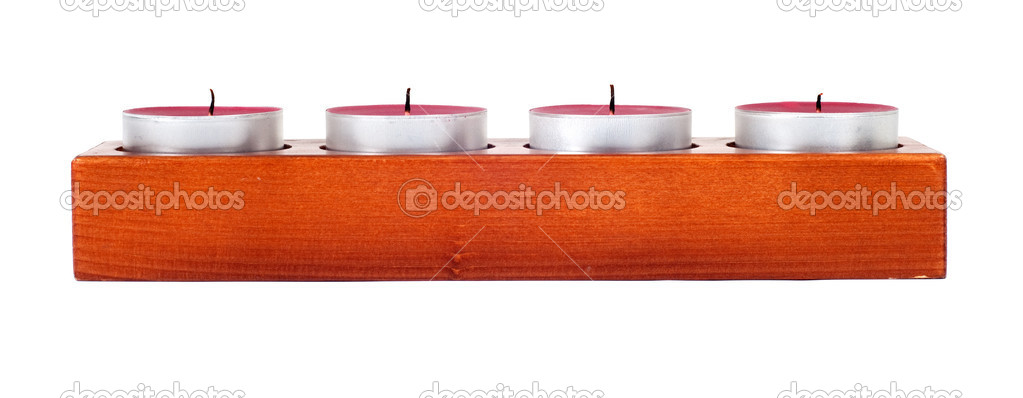 Wooden candleholder or candlestick with four candles isolated on white background — Stockfoto #10237671