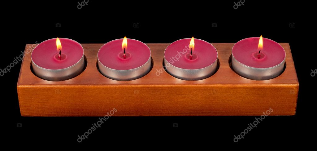Wooden candleholder or candlestick with four burning or flaming  candles isolated on black  background — Stock Photo #10237674