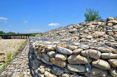 Gabion on the bank of the river — Stock Photo