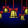 A lot of Christmas bells with red ribbons - Stock Photo