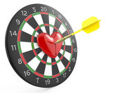 Dart hit the heart in the center of darts board — Stock Photo