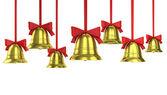 Un montón de campanas de navidad con cintas rojas — Foto de Stock