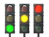 Set of traffic lights with red, yellow and green lights — Stock Photo