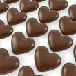 Many heart shaped chocolate candies — Stock Photo