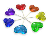 Seven heart shaped lollipops colored as rainbow — Stock Photo
