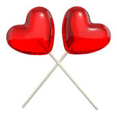 Two crossed heart shaped lollipops — Stock Photo