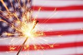 Sparkler and usa flag — Stock Photo