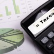 Stock Photo: Tax or taxes concept with business calculator