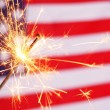 Sparkler and usa flag — Stock fotografie #9297434