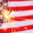 Sparkler and usa flag — Stock Photo #9297434