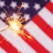 Stock Photo: Sparkler and usa flag
