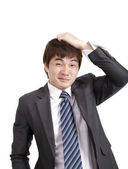 Embarrassment asian businessman — Stock Photo