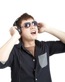 Portrait of young man with glasses and headphones isolated on white — Stock Photo