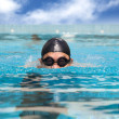 Man in the Swimming pool with breast stroke — Stock Photo