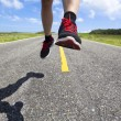 closeup of running legs on the road — Stock Photo