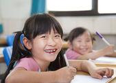 Happy children in the classroom — Stock Photo