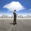 Businessman holding smart phone with cloud computing background — Stock Photo