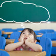 Little Girl with Thinking bubble in the classroom — Stock Photo