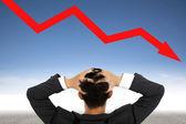 Depression businessman watching falling financial line — Stock Photo