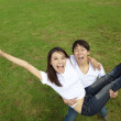 Happy asian couple on the grass — Stock Photo #8096149