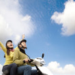 Happy young couple having fun on a scooter — Stock Photo #8096254