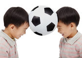 Happy kids holding a football above their head — Stock Photo