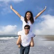 Happy couple running in the water at the beach — Stock Photo #8185012