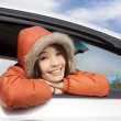 Young woman in a car with winter wear — Stock Photo #8223653