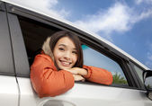 Happy young asian woman in the car — Stock Photo