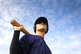 Young baseball player with bat — Стоковое фото