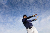 Young baseball player taking a swing — Stock Photo