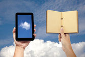 Hand holding book and tablet pc with cloud computing concept — Stock Photo