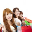 Three young women with shopping bag and isolated on white background — Stock Photo
