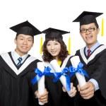 Graduation students isolated on white background — Stock Photo #8887848