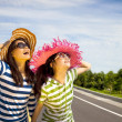 Happy girls watching the sky and enjoy summer vocation — Stock Photo