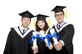 Graduation students isolated on white background — Stock Photo