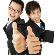 Happy asian businessman with thumbs up — Stock Photo