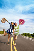 Two girls having fun on the road trip at summertime — Stock Photo