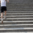 Running man on stairs - Stock Photo