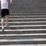 Running man on stairs — Stock Photo