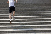 Running man on stairs — Stock Photo