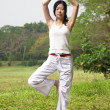 Yoga woman  on the grass — Stockfoto
