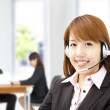 Smiling asian businesswoman customer service on the phone — Stock Photo