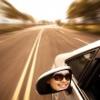 Young woman driving car on the road — Stock Photo