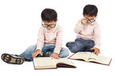 Children reading book on the floor and isolated on white — Stock Photo